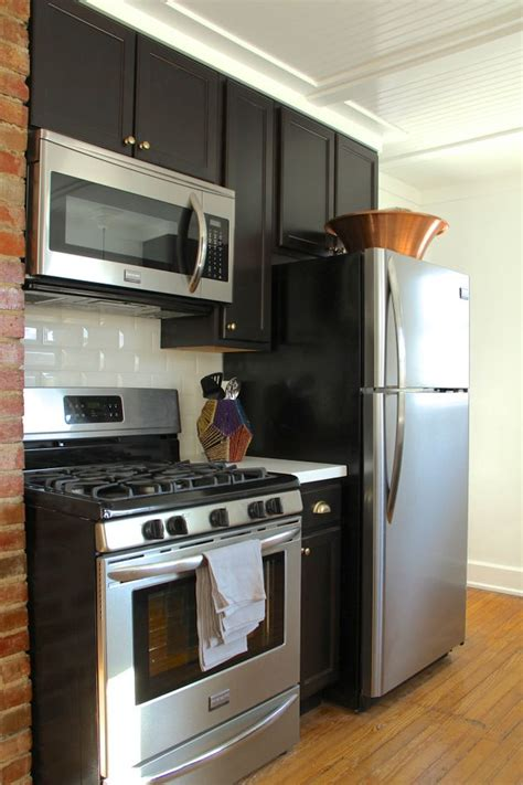 Example of a 12 inch base cabinet between a stove a fridge
