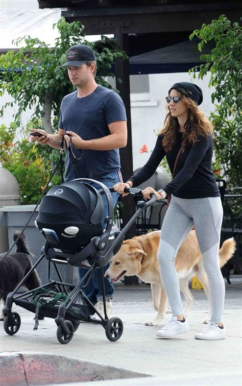 Troian Bellisario Takes a Family Stroll with Her Husband