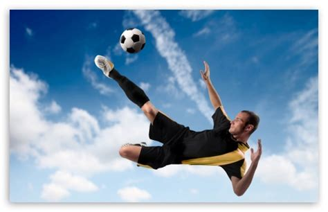 Football Player Kicking The Ball in Mid Air Ultra HD