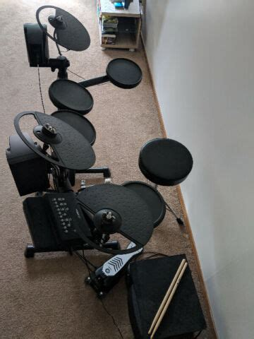 Yamaha DTX drums (comes with monitor speakers, sticks, and
